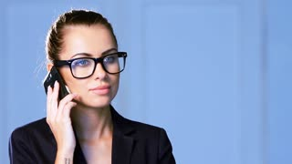 Beautiful business woman is talking cell phone