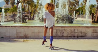 Beautiful Girl with Afro Haircut on Roller Skates