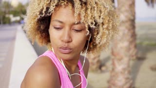 Beautiful girl with afro haircut on the beach