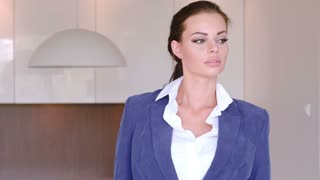 Beautiful Stylish Young Businesswoman Standing With Folded Arms