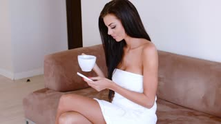 Beautiful Woman Drinking Coffee And Chatting On A Mobile Phone