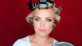 Beautiful woman in hair curlers