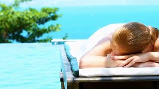 Beautiful woman lying at spa bed