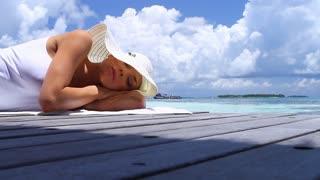 Beautiful woman resting near water at Maldives