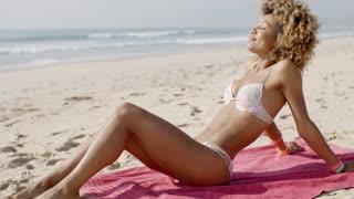 Beautiful Woman Sunbathing On A Beach