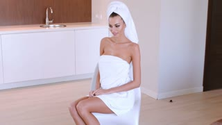Beautiful Woman With Her Hair And Body Wrapped In Clean Fresh Towels