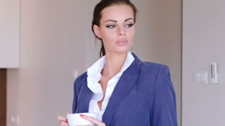 Beautiful Young Businesswoman With Cup Of Hot Coffee