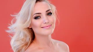 Beautiful young woman applying blusher