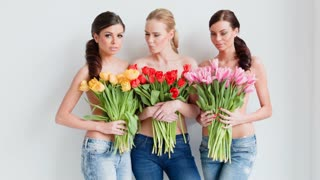 Beautiful young women with tulips