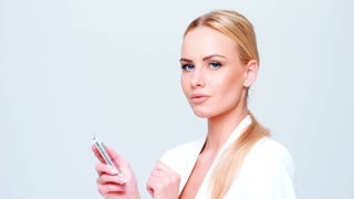 Blond Business Woman Using Mobile Phone