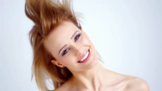 Blond Girl Shakes Her Hair in Slow Motion