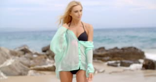 Blond Woman in Bikini and Cover Up on Rocky Beach