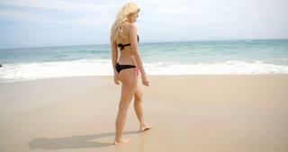 Blond Woman in Thong Bikini Walking on Beach
