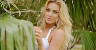 Blond Woman in White Bikini Amongst Palm Trees