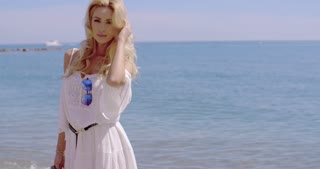 Blond Woman in White Sun Dress Standing on Beach