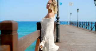 Blond Woman on Pier and Looking Back Over Shoulder