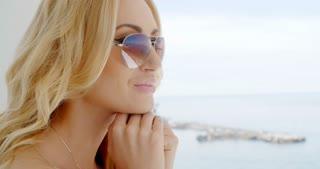 Blond woman wearing mirrored sunglasses