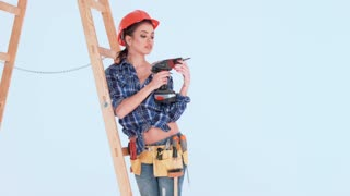 Brunette Girl in Worker Outfit Posing Against Ladder