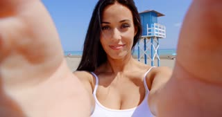 Brunette Woman Taking Self Portrait on Beach
