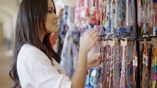 Brunnette Woman Shopping For Clothing