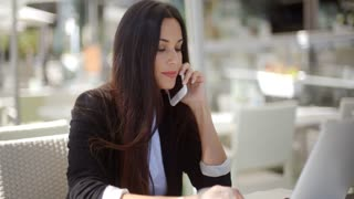 Businesswoman checking her mobile phone