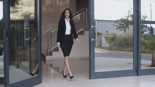 Businesswoman walking through an office complex