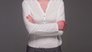 Casual Dressed Beautiful Woman Posing With Arms Crossed
