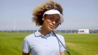 Charismatic smiling young woman golfer