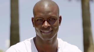 Close up of smiling handsome bald black man