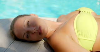 Close Up of Woman Lying Next to Swimming Pool