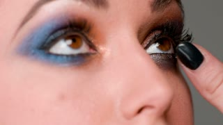Close Up on Eyes Whe Make Up Artist Doing Her Job