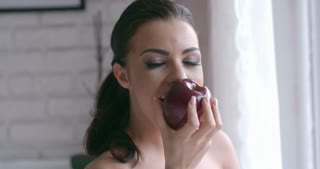 Close up Pretty Woman Biting Sweet Red Apple