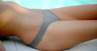 Close Up Woman in Bikini Lying by Swimming Pool