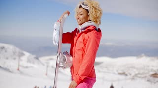 Confident skier with skis and gloves on hill