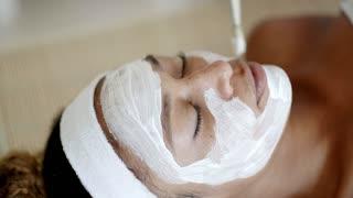 Cosmetician Applying Facial Mask