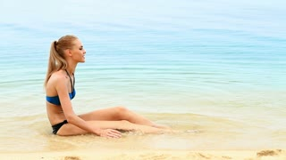 Cute and fresh woman relaxing at the beach