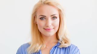 Cute Beautiful Blond Woman Looking at Camera