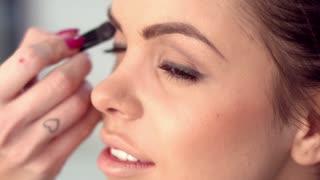 Cute Brunette Getting Professional Makeup