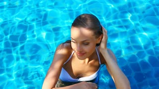 Cute girl in swimming pool