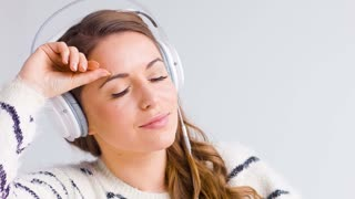 Cute Girl Listen To The Music In Headphones