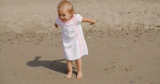 Cute little girl playing on the beach