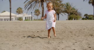 Cute Little Girl Walking on the Beach