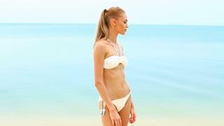 Cute woman in bikini at the seaside