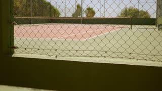 Empty outdoor all weather tennis court