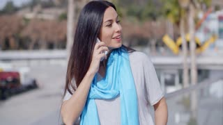 Enthusiastic female using phone outdoors