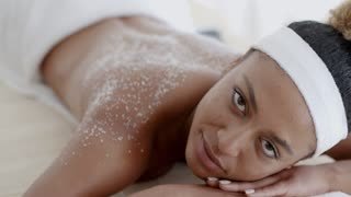 Female Getting A Salt Scrub Treatment