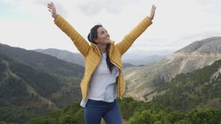 Female hiker rejoicing in the mountains