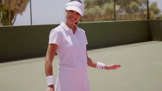 Female Tennis Player with Racket on Sunny Court