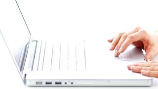 Female Typing on Laptop Keyboard
