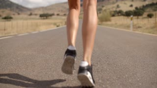 Fit Girl Running on Mountain Road in Spanish Andalucia, Slow Motion Video